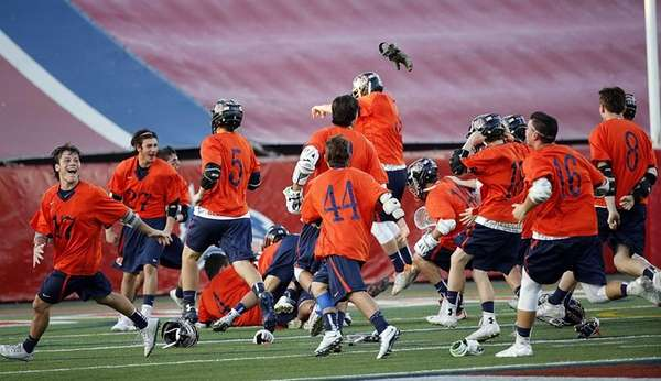 The Manhasset boys lacrosse team celebrates its last-minute
