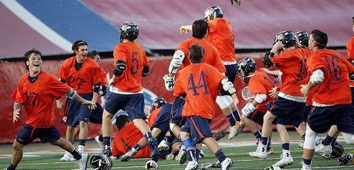 The Manhasset boys lacrosse team celebrates its last-minute