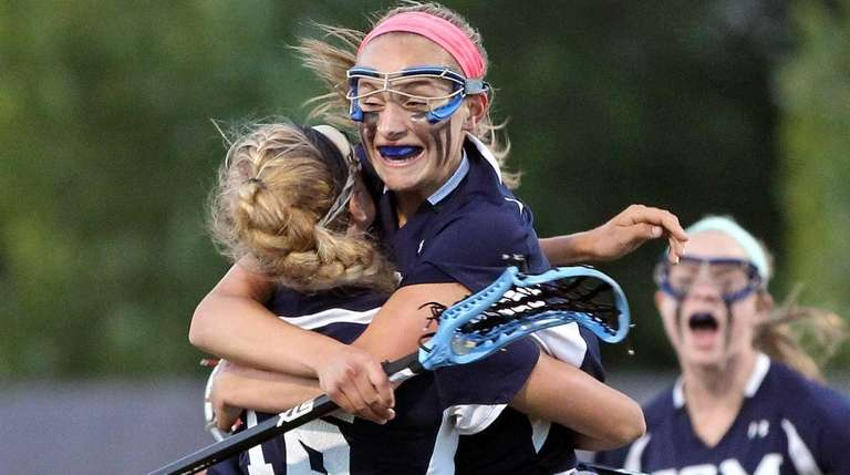Eastport-South Manor's Kasey Choma celebrates her goal at