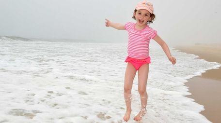 Sadie Hart runs along the surf at Sagg