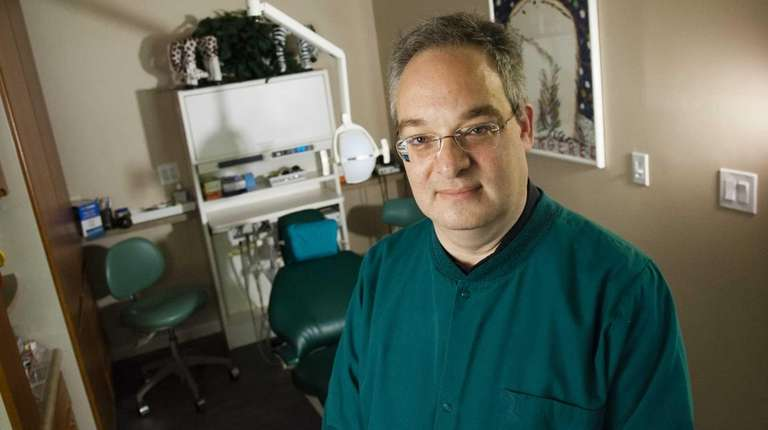 Dr. Howard W. Schneider, a pediatric dentist, in