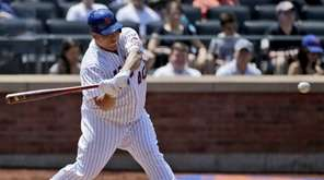 New York Mets pitcher Bartolo Colon hits an