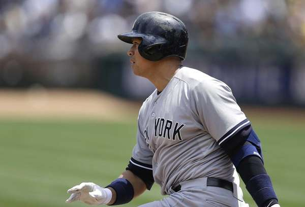 The New York Yankees' Alex Rodriguez swings for