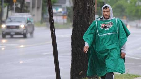 A man tries to keep dry on Waverly