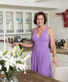 LuAnn de Lesseps stands in the kitchen