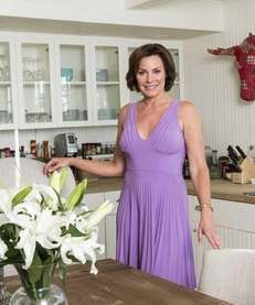 LuAnn de Lesseps stands in the kitchen