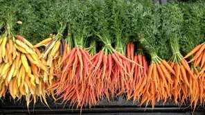 Multi-colored carrots from Green Thumb Farm in Water