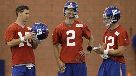 New York Giants quarterbacks Eli Manning, left, Ricky