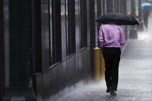 A man runs during a heavy rain storm