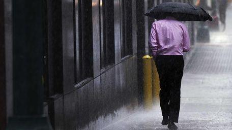 A man runs during a heavy rain storm