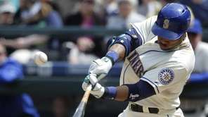 The Seattle Mariners' Robinson Cano hits a sacrifice