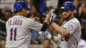 The New York Mets' Daniel Murphy is met