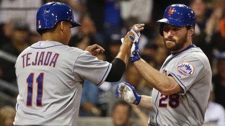 The New York Mets' Daniel Murphy is met