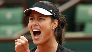 Serbia's Ana Ivanovic clenches her fist as she