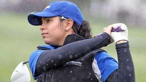 Nicolette Dilluvio from Kellenberg tees off in the