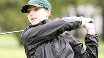 Tess Murphy from Holy Trinity tees off at