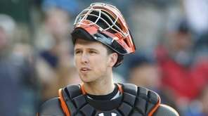 San Francisco Giants catcher Buster Posey directs words