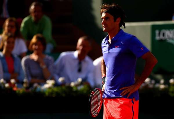 Roger Federer of Switzerland reacts during his men's