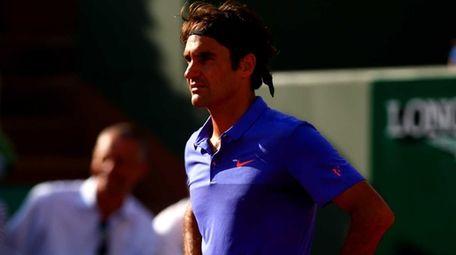 Roger Federer of Switzerland reacts during his men's