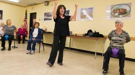 Ellen Coven leads a warm-up exercise during her