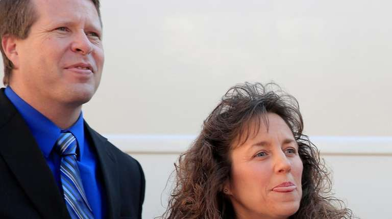 Jim Bob Duggar and Michelle Duggar attend a