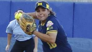Michigan infielder Lindsay Montemarano throws to first in