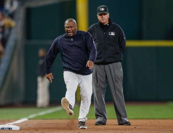 Manager Lloyd McClendon of the Seattle Mariners kicks