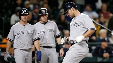 New York Yankees' Brett Gardner, left,and Stephen Drew