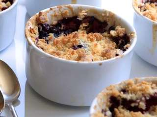 Peaches and blueberries are cooked under a crisp