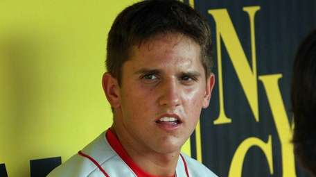 Shortstop Gavin Cecchini in the dugout during the