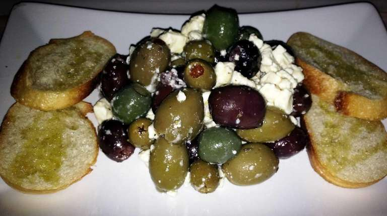 Olives and feta are an appetizing opener at