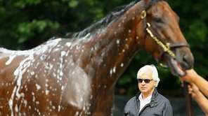 Head trainer Bob Baffert, looks on as American