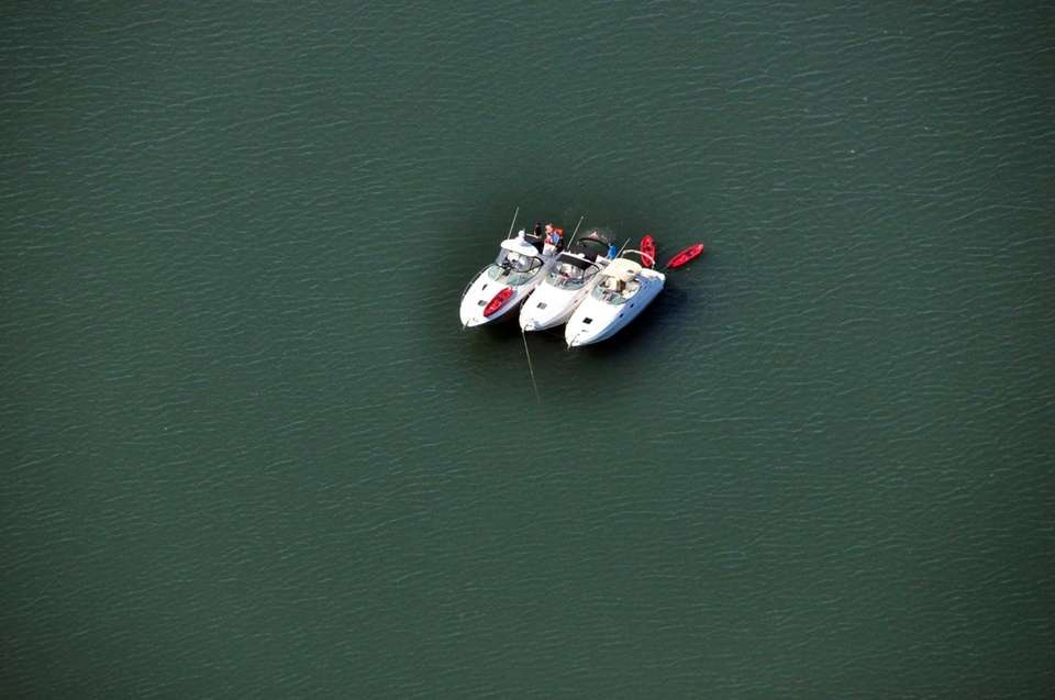 Shown is an aerial view of three boats