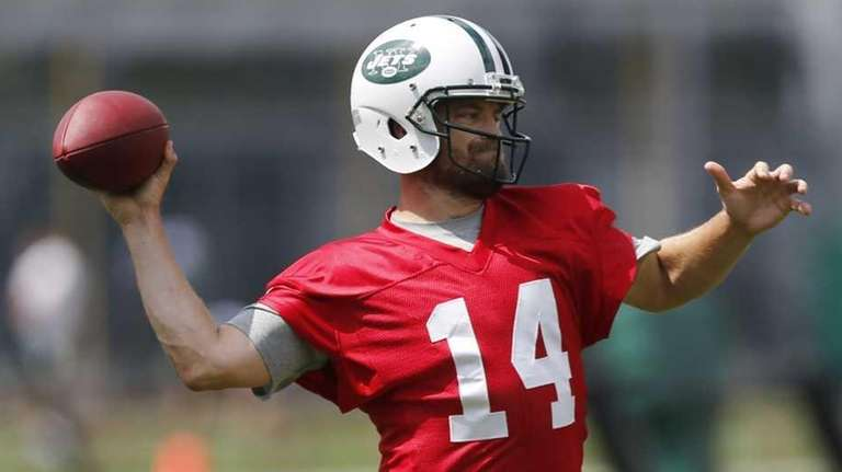 New York Jets quarterback Ryan Fitzpatrick, right, throws