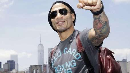 Boxer Miguel Cotto poses for a picture in