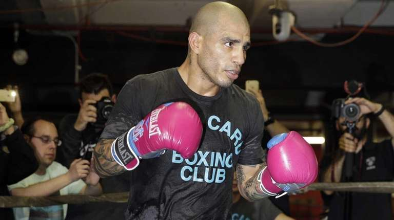 Boxer Miguel Cotto works out at a gym