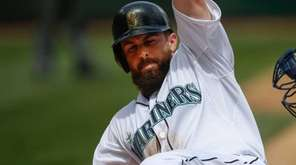 Dustin Ackley of the Seattle Mariners is tagged