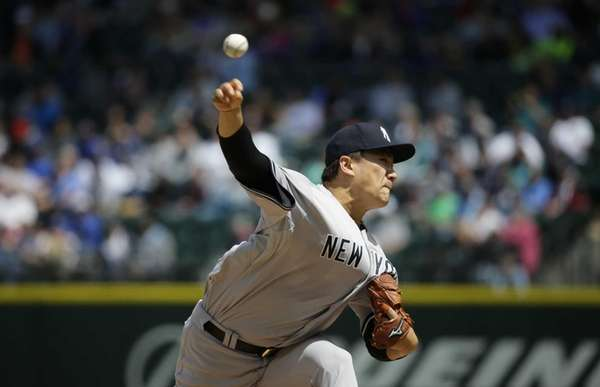 New York Yankees starting pitcher Masahiro Tanaka throws