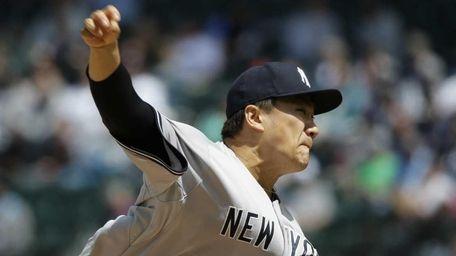 New York Yankees starting pitcher Masahiro Tanaka throws