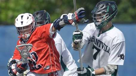 Cold Spring Harbor's Ian Laviano, left, shields the