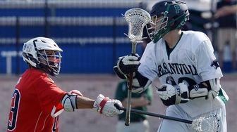 Cold Spring Harbor's Matt Degennaro, left, knocks the