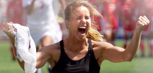 USA's Brandi Chastain shouts after scoring the game-winning