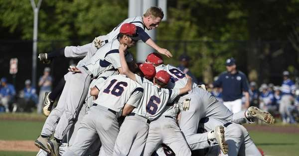 MacArthur players celebrate their 4-3 victory against Oceanside