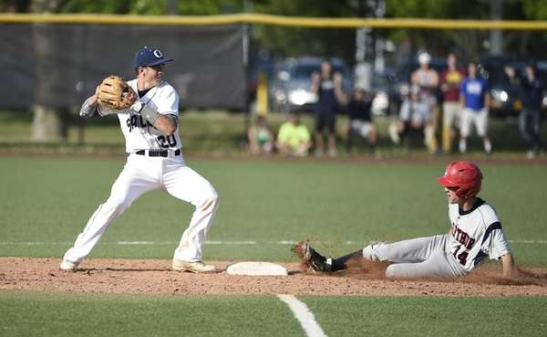 MacArthur outfielder Chris Danetti is forced out at