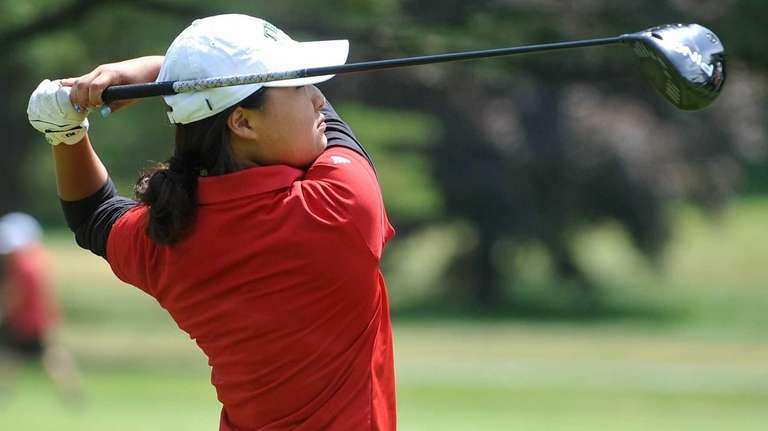 Syosset senior Elizabeth Choi tees off on the