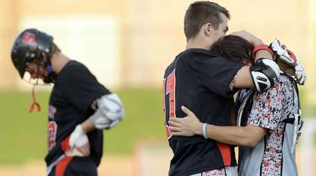 Syosset's Alex Concannon, right, is consoled by teammate