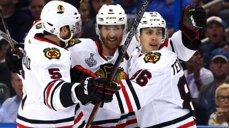 Teuvo Teravainen celebrates his third period goal with