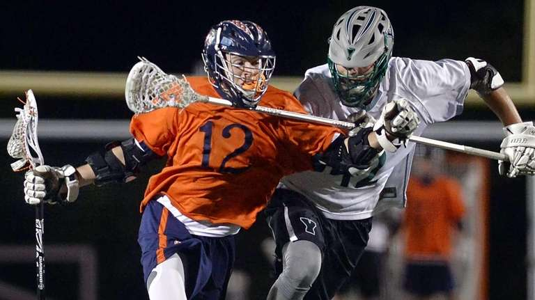 Manhasset's Matthew Gavin, left, is defended by Yorktown's