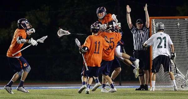 Manhasset' players mob Matthew Gavin, top center, after