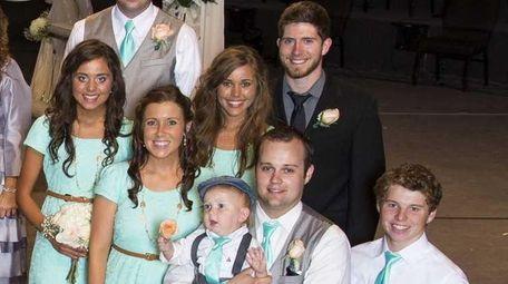 Jessa Duggar, far right, with her family, of